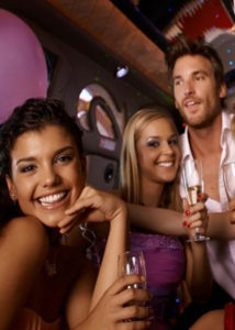 Image of three people celebrating in a party bus